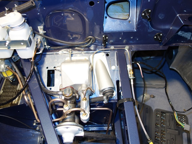 The routing of the wiring harness and vacuum pip was routed within the bulkhead void and enters the engine bay via the hole for the speedometer drive