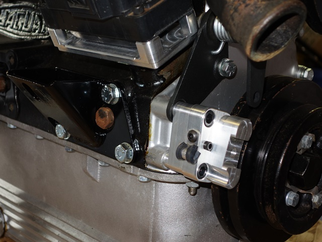 The sensor bracket is mounted using two of the bolt holes on the timing cover. The end of the bracket is adjustable, allowing movement to vary the air gap to the trigger wheel
