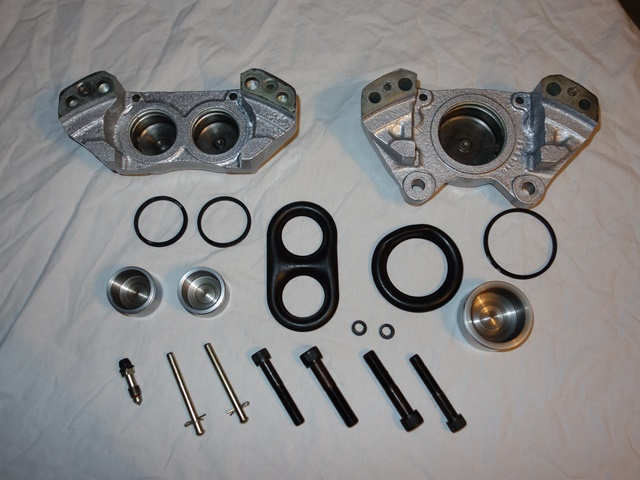 The components for the front calipers - including the small circular seals between the two halves