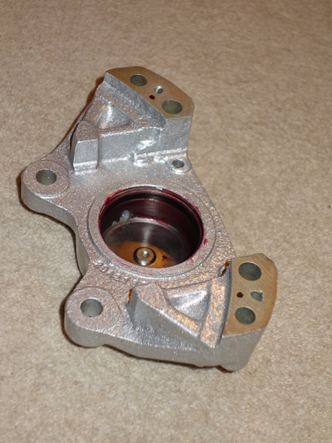 The piston bore and seal recess were covered with Girling Red Rubber grease before the seal was inserted into the recess