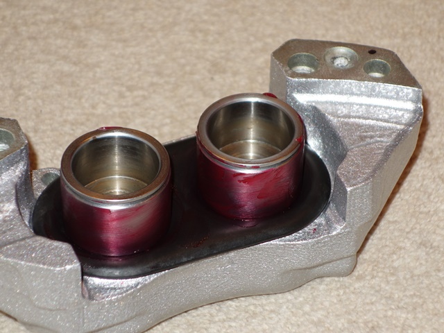 The pistons are also given a generous covering of rubber grease to ease fitting