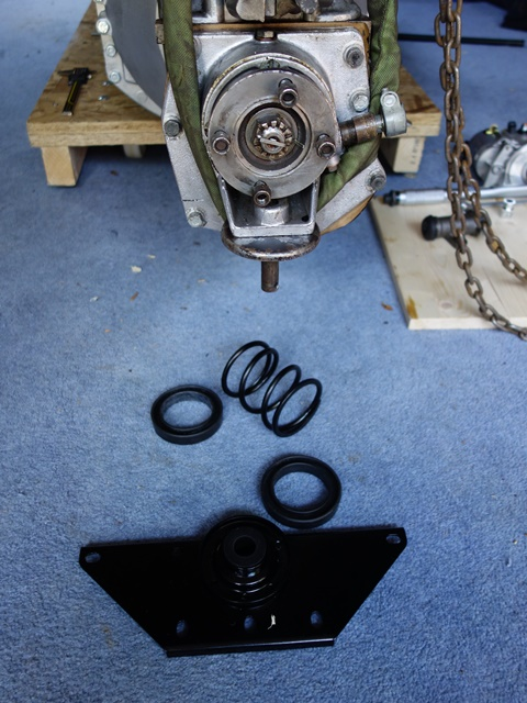 The gearbox mounting bracket and damping spring, which sits in two rubber mouldings