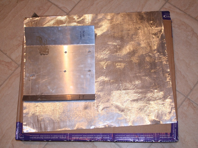 A sheet of Zircotec II was cut slightly oversize to cover the exhaust side of the heatshield