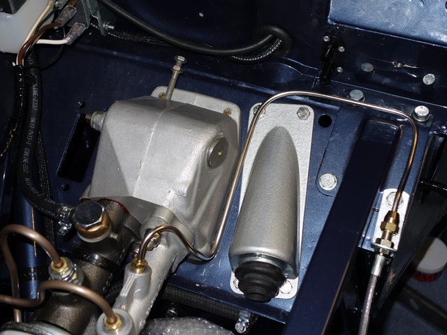 The routing of the clutch piping from the master cylinder to the flexible hose union. Note - not fitted at this stage is the P-clip on the LH frame bolt, securing the pipe