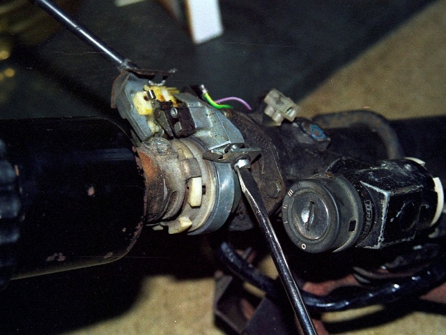Removal of the semi-circular bracket securing the indicator mechanism to the steer column housing