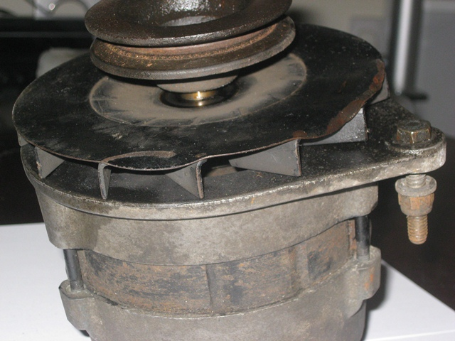 With the end nut removed, the pulley and fan can be removed