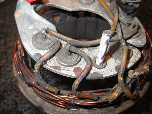 The stator's three field coils attached the stator to the rectifying diode housing