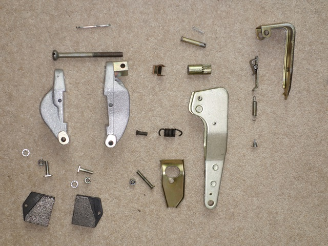 The components for the handbrake calipers and self-adjusting mechanism ready to be re-built