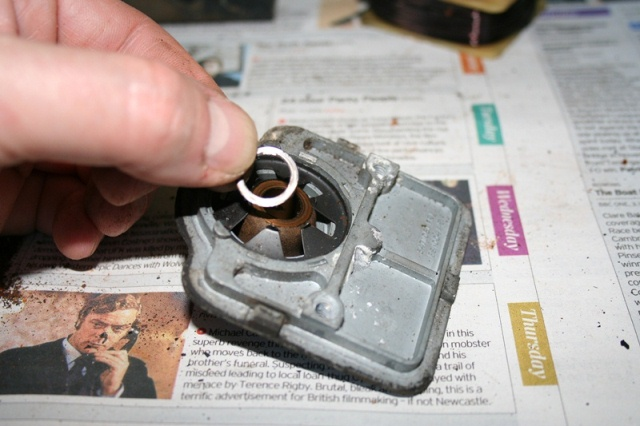 Thrust washer between the front end plate and the armature