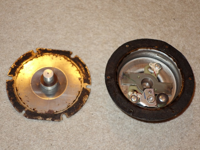 The diaphragm removed, showing its ferrous attachment and disc operating to operate the contact points