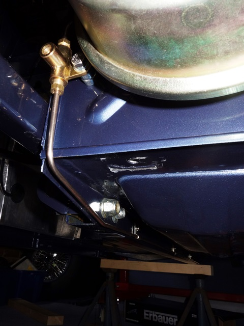 From the brake light switch union, the rear pipe passed down the LHS of the underside of the car