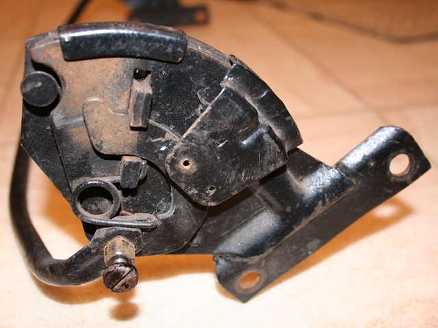 The reclining mechanism showing the connecting bar which operates a toothed locking mechanism and also one of the return springs