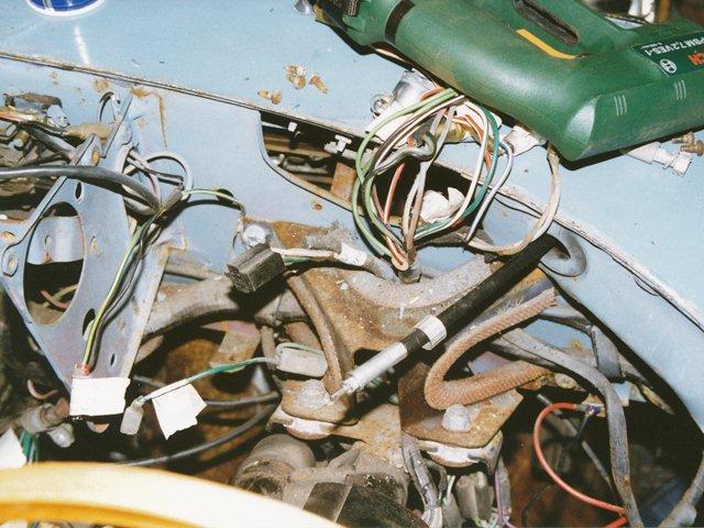 The dash loom behind the steering column mount